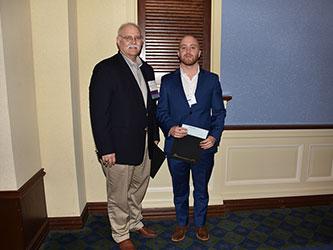 Stephen Austin Presents Christopher Addison a $2,000 Scholarship