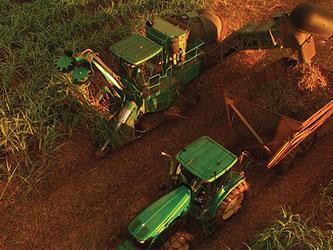 Tractors harvesting crops